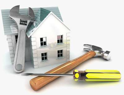 various construction tools lay around a small home